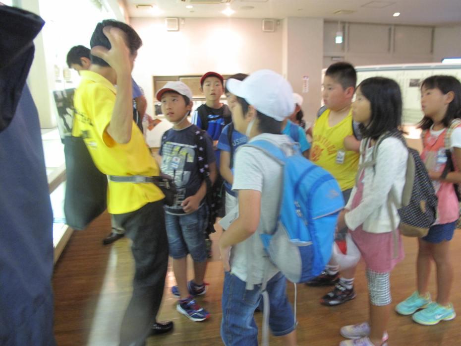 Guide speaks at Dr. Nagai's